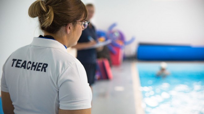 teacher_overlooking_pool