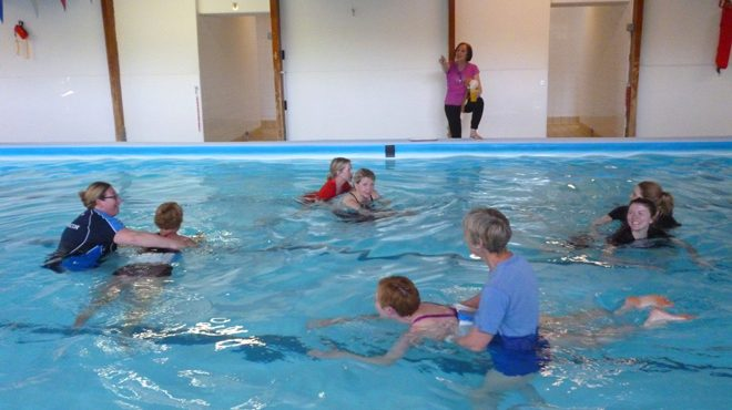 how to become a swimming teacher uk